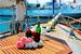 Маленький столик на палубе яхты Роял Марис